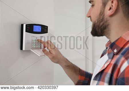 Man Entering Code On Home Security System, Closeup