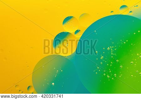 Macro Photography Of The Oil Drops On The Water Surface.vibrant Gradient Background.cosmic Circles L
