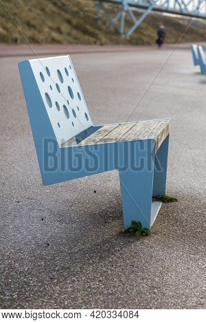 Blue Chair With Wooden Seat Is Fixed On The Boulevard Of Scheveningen To Rest On