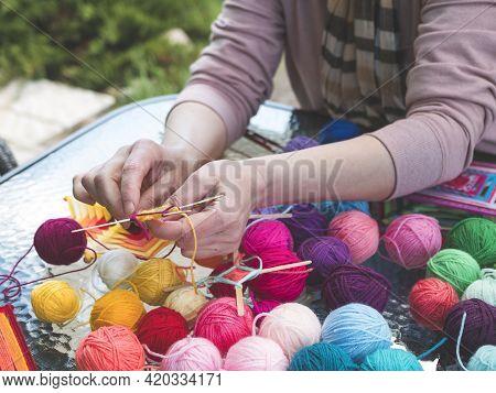 Making Mandala From Colored Yarn And Sticks. Mandala Weaving. Concept Of Craft, Handcraft, Hobby