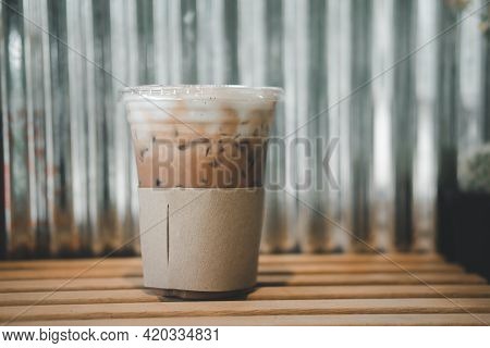Iced Mocha In Cups With Brown Paper Sleeve On Table With Zinc Background. Relax Time
