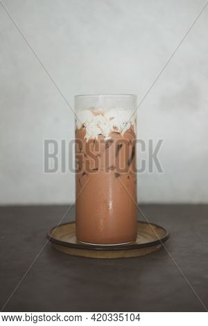 Iced Mocha With Cream On Top In Tall Glass.