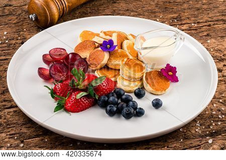 Delicious Pancakes With Berries, Honey Or Maple Syrup. Homemade Pancakeson White Plate