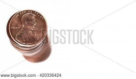 Stack of pennies isolated on white background representing savings wealth and investing