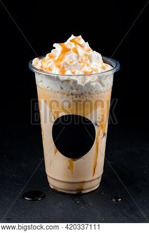 Vanilla Milkshake Covered With Whipped Cream In Plastic Glass