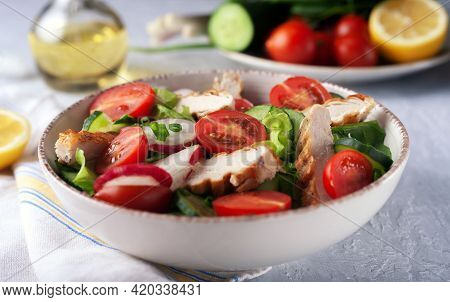 Diet Food. Grilled Chicken Breast, Fillet And Fresh Vegetable Salad Of Lettuce, Spinach, Cucumber An