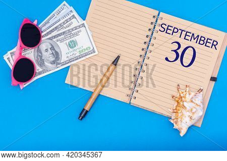 30th Day Of September. Travel Concept Flat Lay - Notepad With The Date Of 30 September Pen, Glasses,