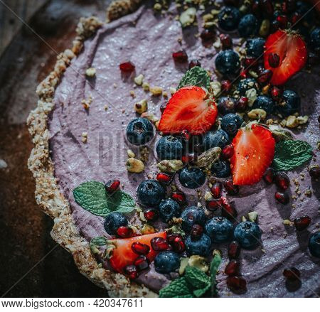 Sweet potato tart topped with strawberries and blueberries