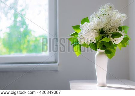 A Bouquet Of White Lilac In A Vase . Spring Flowers .smell. Flowers In A Vase.