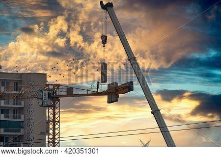 Gurgaon, Delhi, India - Circa 2021: Construction Crane Being Built Using A Secondary Crane Shot Agai