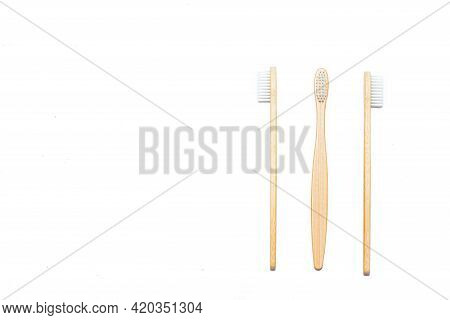 Bamboo Toothbrush On An Isolated Background. Tooth Cleaning. Article About Choosing A Toothbrush. Ar