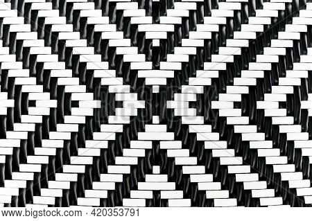 Abstract Background Of Pattern Of Black And White Plastic Handcraft Weave Design For Texture
