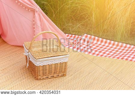 Woven Wood Picnic Basket In Park. Summer Sunny Day And Picnic Time Concept