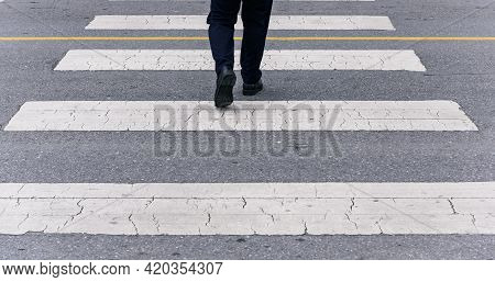 Back View Of Businessman Crossing The Street On Crosswalk