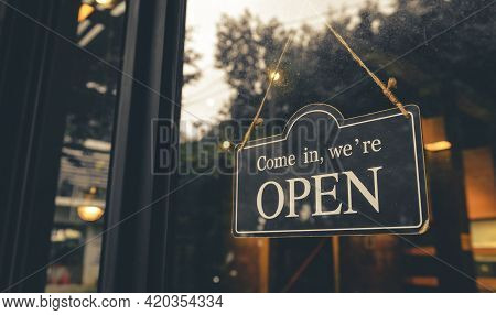 Come In, We Are Open - Open Sign Broad Hang On Entrance Door With Copy Space At Coffee Shop Or Resta