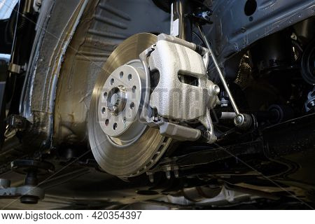 Brake Disc And Brake Caliper Installed On A Modern Car. Car Service And Spare Parts.