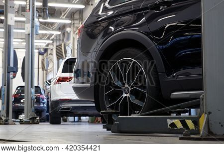 Moscow Russia - May 11 2021: Luxurious Car In A Car Service. In The Background Is The Interior Of A