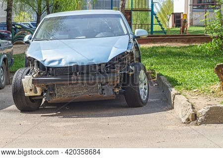 The Car That Was Wrecked In The Accident With Damage To The Bumper And Side Wings Is Parked In The C