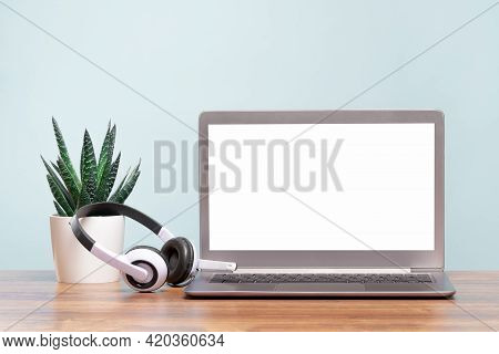 Laptop. Mockup Blank Screen And Headphones On Wooden Desk. Distant Learning. Working From Home, Onli