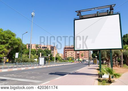 Empty Mockup Of Blank White Billboard On Street In Marrakesh, Morocco. Outdoor Billboard Or Advertis