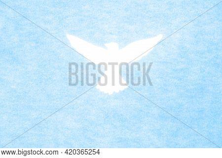 White Dove Silhouette On Blue Background. Holy Spirit. Pentecost Sunday Concept.