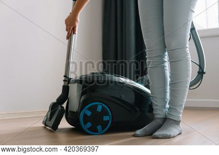 Technologies That Facilitate Wet Cleaning. Modern Household Appliances. Woman Holds A Telescopic Tub