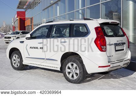 Russia, Izhevsk - February 17, 2021: Haval Showroom. New Modern Haval H9 Car Is Standing Near The De