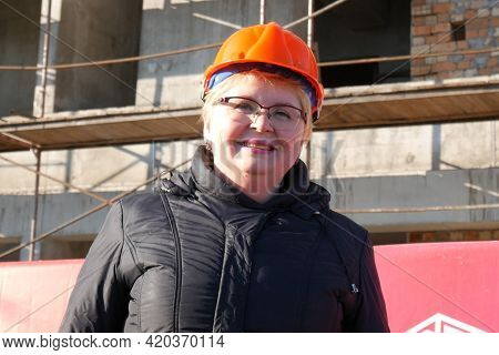 Woman Engineer In The Hard Hat With Laptop On Storehouse Background, Closeup
