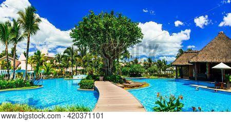 Tropical holidays .Resort and Spa Luxury hotel Mauritius. Splendid territory  swim pool and bars. nov. 2016