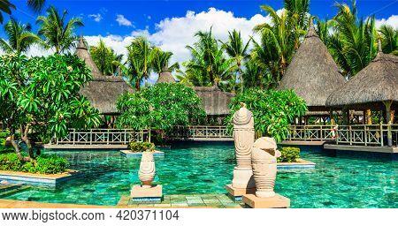 Tropical holidays .La Pirogue Resort  and Spa Luxury hotel Mauritius. Splendid territori with swim pool and bars.november 2016