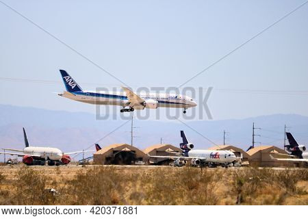 May 12, 2021 In Victorville, Ca:  Airliner Aircraft Arriving At The Victorville, Ca Airplane Graveya