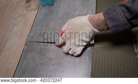 Laying Ceramic Tiles On The Floor. Ceramic Tile. The Tiler Is Laying Ceramic Wall Tiles On Top Of Th