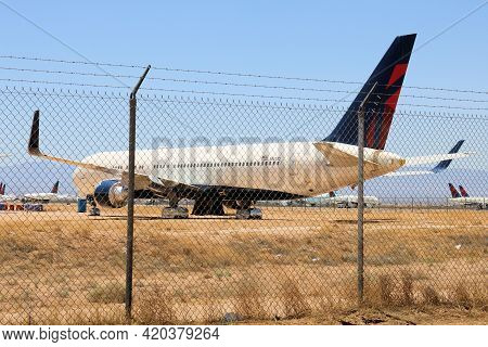 May 12, 2021 In Victorville, Ca:  Retired 767 Airliner Aircraft Stored In The Victorville, Ca Airpla