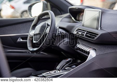 Dark Luxury Car Interior. Black Leather Multifunctional Steering Wheel, Start And Stop Engine Buttom