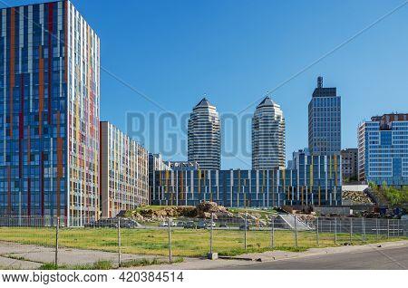 Newly Built Urban High-rise Buildings On A Sunny Summer Day
