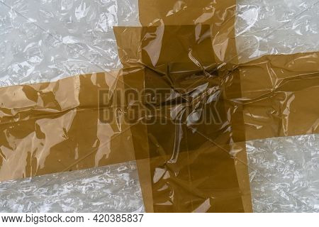 Adhesive Tape On A Bubble Wrap. Wrinkled Abstract Plastic Background
