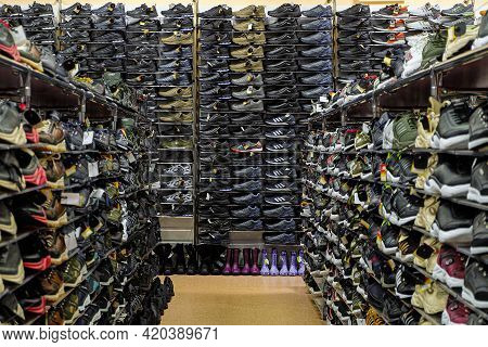 Belgorod, Russia - September 21 2019: Shopping Rows In Shoes Store. Multi-storey Shelves With Rows O