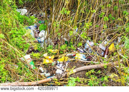 Kemerovo, Russia - 27 August 2019. Pile Of Packaging Waste Left In The Forest After The Rest Of Irre