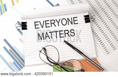 Everyone Matters Text On Chart , Office Supplies, Business Concept