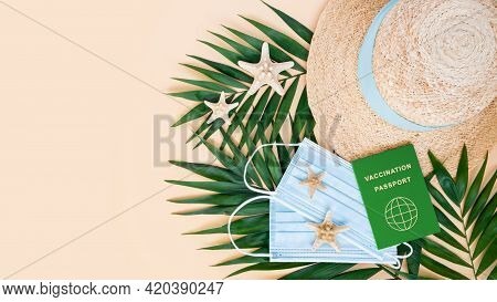 Green Vaccination Or Immunity Passport, Medical Mask, Hat, Sea Stars And Palm Leaves On Neutral Back