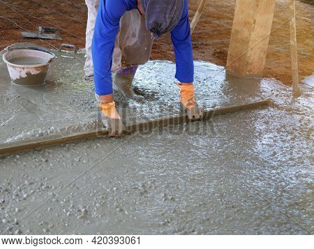 Plasterers Are Using Equipment To Smooth The Plaster.