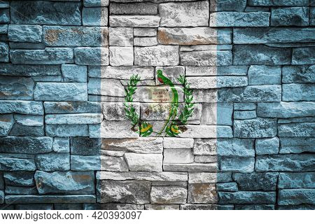 National Flag Of Guatemala On Stone  Wall Background.the Concept Of National Pride And Symbol Of The