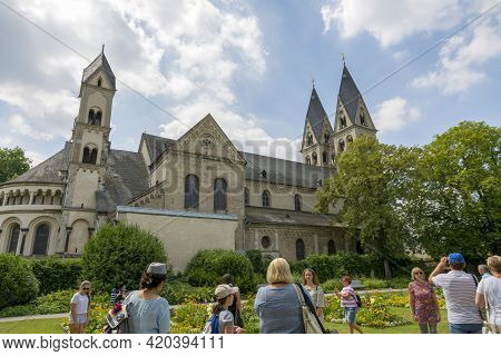 Koblenz, Germany - July 07, 2018: People Walk Near The Walls Of The Basilica Of St. Castor In The Ci