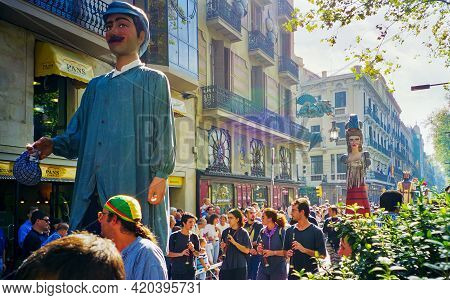 Barcelona, Spain - September 23, 1999: Locals Parading With Giant Figures (gigantes), Part Of The Tr