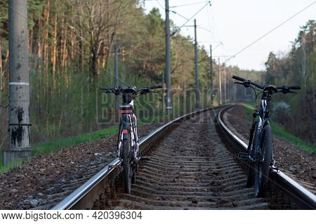 Two Bicycles On The Train Tracks. Bicycles On Rails. Trip Around The World, Bicycles On The Road In