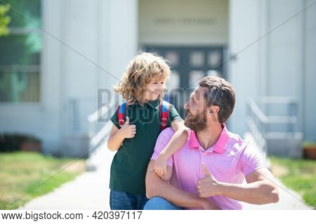 School Boy Going To School With Father. Happy Face. Thumbs Up Sign.