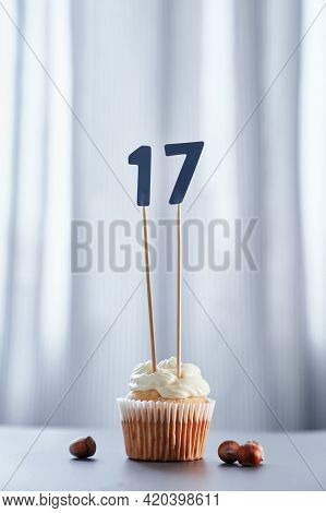 Homemade Birthday Cupcake With Creamy Topping And Number 17 Seventeen. Minimalistic Birthday Or Anni