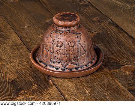 Original Brown Clay Butter Dish Whith Ornament And Embossing On Wooden Tabletop