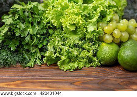 Green Vegetables Frame. Fresh Green Vegetables With Space For Text. Fitness Food Cooking On Wooden B