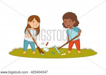 Cheerful Girls Enjoying Spring Season Engaged In Litter Pick Gathering Rubbish With Rake And Broom V